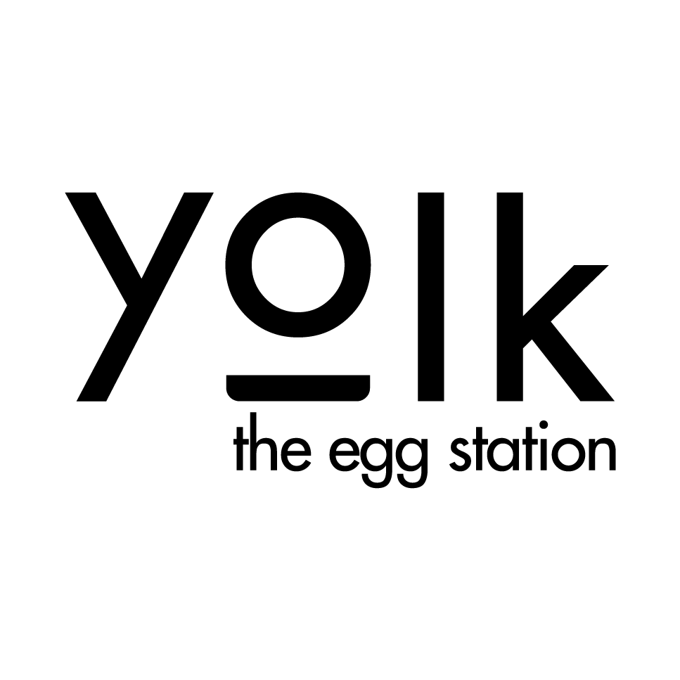 This image has an empty alt attribute; its file name is Yolk-The-egg-station-logo.png